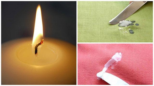 Огонек свечи, воск на зеленой и красной ткани