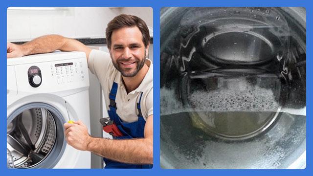 Специалист ремонтирует стиральную машину